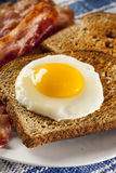Organic Sunnyside up Egg with toast and bacon Stock Image