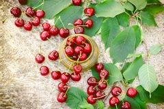 Organic, sweet cherry in rustic bowl. Refreshing and juicy berry fruit Stock Photo
