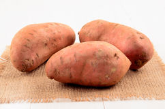 Organic sweet potatoes on jute Stock Image