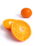 Organic Tangerine cut in half. On white background stock images