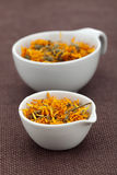 Organic Tea in White Bowls on Brown Fabric Royalty Free Stock Photos