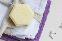 Organic thyme honey soap on cotton towels, beauty spa Stock Photo