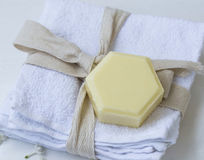 Organic thyme honey soap on cotton towels, beauty spa Royalty Free Stock Photo