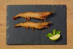 Organic Tiger shrimps on black stone background Royalty Free Stock Image