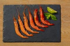 Organic Tiger shrimps on black stone background Royalty Free Stock Images