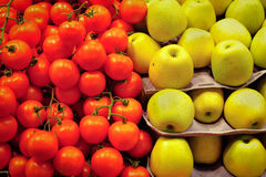 Organic tomato and apple on market Royalty Free Stock Photos