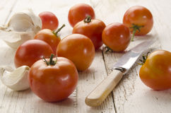 Organic tomato on an old wooden table Royalty Free Stock Photo