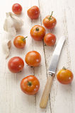 Organic tomato on an old wooden table Royalty Free Stock Photos