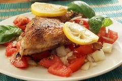 Organic tomato salad, roasted chicken Stock Image
