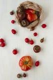Organic tomatoes. Abundance. Fresh organic beef, kumato and cherry tomatoes in paper bag over white wood table. Symbol of abundance Royalty Free Stock Image