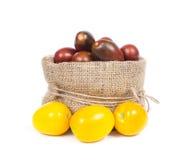 Organic tomatoes in basket Stock Photos