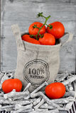 Organic tomatoes in a jute bag Royalty Free Stock Photo