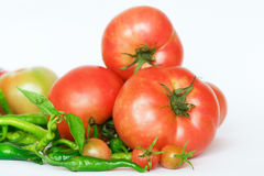 Organic tomatoes and peppers Stock Images