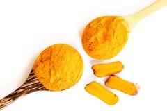 Organic turmeric (curcuma) powder with spoon Stock Photography
