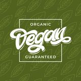 ORGANIC VEGAN GUARANTEED typography. Green seamless pattern with leaf. Handwritten lettering for restaurant, cafe menu Royalty Free Stock Photo
