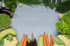 Organic vegetable background with copy space for text in the centre. Fresh ingredients for salad, soup and healthy or diet dishes. Organic vegetable background Royalty Free Stock Images