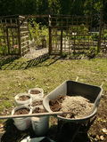 Organic vegetable garden: mixing soil wheelbarrow Stock Image