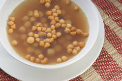 Organic vegetable soup and fried batter pearls Stock Photo