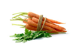 Organic Vegetables. Studio macro of organic vegetables, carrots and flat leaf parsley, on a white background. Copy space Stock Photography