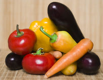 Organic vegetables. Mixed organic vegetables pepper egg plant and bell pepper Royalty Free Stock Images