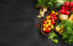 Organic vegetables with cherry tomatoes and spices on wooden bac Royalty Free Stock Photo