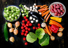 Organic vegetables on dark wooden table. Top view Stock Photography