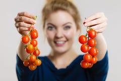 Woman holding fresh cherry tomatoes royalty free stock photo