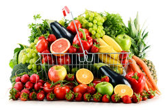 Organic vegetables and fruits in shopping basket on white Royalty Free Stock Images