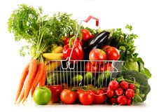 Organic vegetables and fruits in shopping basket on white Stock Photo
