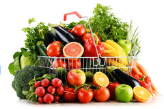 Organic vegetables and fruits in shopping basket on white Royalty Free Stock Image