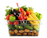 Organic vegetables and fruits in shopping basket on white Royalty Free Stock Photos