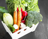Organic vegetables harvest in wooden crate Stock Photos