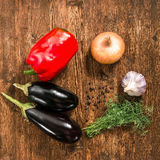 Organic vegetables, healthy food concept. Eggplant paprika onion garlic are on board. view from above Stock Image