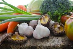 Green Organic, Fresh Vegetables, Broccoli, Vegan,. Organic vegetables, healthy food, fresh vegetables and ingredients on the table in the wood, mushrooms, garlic Stock Photos