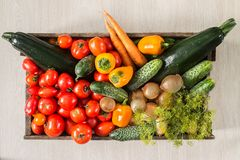 Organic vegetables in an old box. Healthy food. Organic vegetables in an old box. On wooden background Stock Images