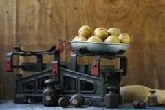 Organic Vegetables, Potatoes. On a wooden background royalty free stock photography