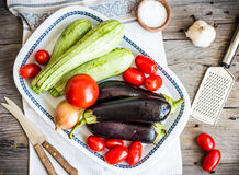 Organic vegetables for ratatouille on gray wooden table, rustic Stock Images
