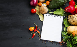 Organic vegetables with recipe notebook Stock Photography