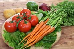 Organic vegetables in rustic setting royalty free stock image