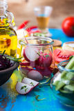 Organic vegetables on rustic table. Radish slices. Salad ingredients. Vegetarian food, concept Royalty Free Stock Photography