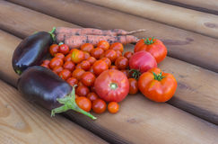 Organic vegetable lying on wooden floor Royalty Free Stock Image