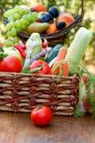Organic vegetables in wicker basket Royalty Free Stock Photos