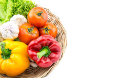 Organic vegetables in the wicker basket Royalty Free Stock Photos