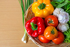 Organic vegetables in the wicker basket Royalty Free Stock Images