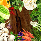 Organic vegetables on wood background Royalty Free Stock Images