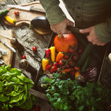 Organic vegetables on wood Royalty Free Stock Photos