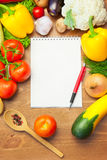 Organic Vegetables on Wooden Table and Notebook Stock Images