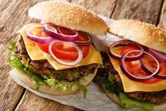 Organic vegetarian burger with mushrooms patty, vegetables and cheddar cheese close-up. horizontal. Organic vegetarian burger with mushrooms patty, vegetables royalty free stock image