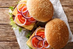 Organic vegetarian burger with mushrooms patty, vegetables and cheddar cheese close-up. horizontal top view. Organic vegetarian burger with mushrooms patty royalty free stock image
