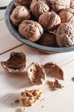 Organic walnuts. In a copper bowl Stock Images